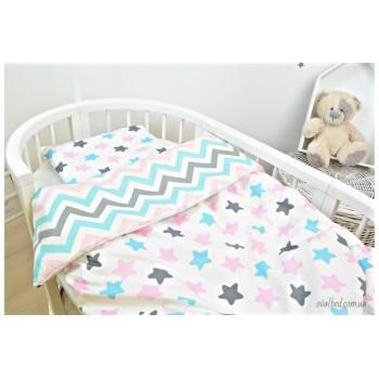 Детское постельное белье в кроватку поплин Звезды-прянички розовые фото 2